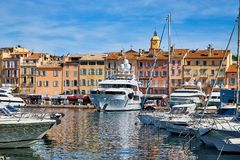 Saint-Tropez, France - September 23, 2018: Yachts and ships moored at the pier in the sea on a Sunny day