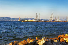 Saint Tropez harbor marina and lighthouse in sunset light Stock Images