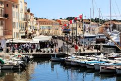 Saint Tropez old harbor Street scene in summer. Quai Jean Jaurès street scene in the old harbor and old town of Saint Tropez a warmth summer afternoon royalty free stock photography