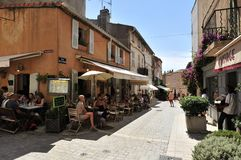 Saint Tropez. Typical provencal restaurants in the street d'Aumale in Saint Tropez - France royalty free stock image