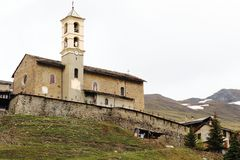 Church of mountain village of Saint-Véran, France. Saint-Véran is the highest village in Europe at 2042 meters altitude, ranked among the most beautiful stock photos