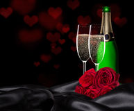 Saint Valentin avec le champagne et les roses Photo stock