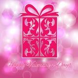 Saint-Valentin. Cadeau sur le fond rose de bokeh. Photos stock