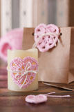 Saint Valentine decoration: handmade crochet pink heart for candle and gift paper package. Selective focus royalty free stock images