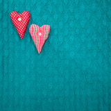 Saint valentine green textured knitted background with hearts Royalty Free Stock Images
