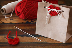 Saint Valentine's day decoration: handmade crochet red heart for Stock Photography