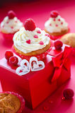Saint Valentine's Day on february 14. Sweets for breakfast and g. Cupcakes for Valentine's Day with present box and fresh raspberries Stock Images