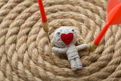 Saint Valentine thread doll. Saint Valentine toy made from white thread with a heart instead of mouth , on a rope background Stock Image