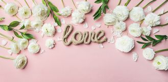 Saint Valentines Day card with ranunculus flowers and word love stock photos