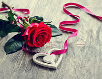 Saint Valentines's Day  rose and heart on wooden background. Romantic background for love message Stock Photo