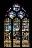 Saint Vincent de Paul gathering with the Daughters of Charity abandoned children. Stained glass, Saint Severin church, Paris, France Royalty Free Stock Photography