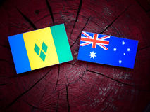 Saint Vincent and the Grenadines flag with Australian flag on a tree stump  Stock Image