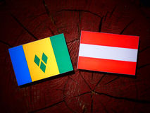 Saint Vincent and the Grenadines flag with Austrian flag on a tr. Ee stump Stock Images