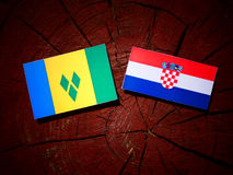 Saint Vincent and the Grenadines flag with Croatian flag on a tr. Ee stump isolated Royalty Free Stock Photo