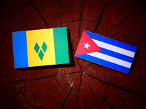 Saint Vincent and the Grenadines flag with Cuban flag on a tree. Stump isolated Royalty Free Stock Photography