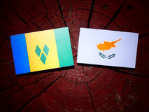 Saint Vincent and the Grenadines flag with Cypriot flag on a tre Stock Photography
