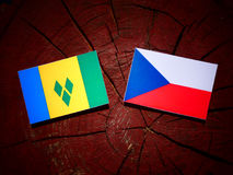 Saint Vincent and the Grenadines flag with Czech flag on a tree. Stump Stock Photography