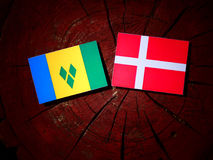Saint Vincent and the Grenadines flag with Danish flag on a tree. Stump isolated Stock Images