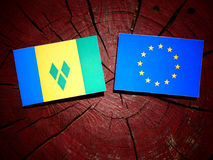 Saint Vincent and the Grenadines flag with EU flag on a tree stu Royalty Free Stock Photography