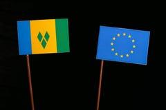 Saint Vincent and Grenadines flag with European Union EU flag  on black Stock Photo