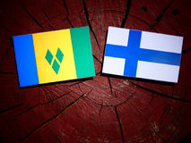 Saint Vincent and the Grenadines flag with Finnish flag on a tre Royalty Free Stock Images