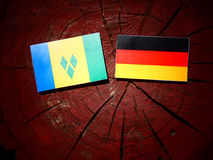 Saint Vincent and the Grenadines flag with German flag on a tree. Stump isolated Royalty Free Stock Photography