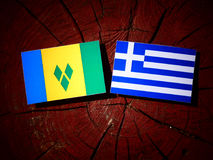 Saint Vincent and the Grenadines flag with Greek flag on a tree. Stump isolated Stock Photography