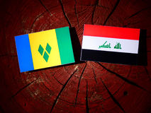 Saint Vincent and the Grenadines flag with Iraqi flag on a tree. Stump isolated Royalty Free Stock Photography