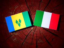 Saint Vincent and the Grenadines flag with Italian flag on a tre Stock Image