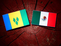 Saint Vincent and the Grenadines flag with Mexican flag on a tre Stock Photography