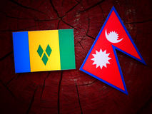 Saint Vincent and the Grenadines flag with Nepali flag on a tree Stock Image