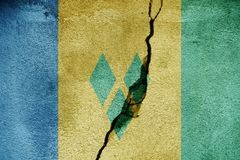 Saint Vincent and the Grenadines   FLAG PAINTED ON CRACKED WALL NICE Royalty Free Stock Photo