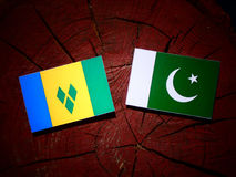 Saint Vincent and the Grenadines flag with Pakistan flag on a tr. Ee stump isolated Royalty Free Stock Photo