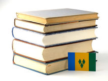 Saint Vincent and the Grenadines flag with pile of books isolate. D on white background Stock Photo