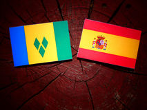 Saint Vincent and the Grenadines flag with Spanish flag on a tre Royalty Free Stock Photography