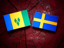 Saint Vincent and the Grenadines flag with Swedish flag on a tre Royalty Free Stock Photos