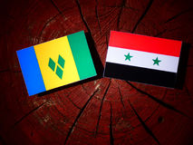 Saint Vincent and the Grenadines flag with Syrian flag on a tree. Stump Royalty Free Stock Image
