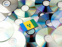 Saint Vincent and the Grenadines flag on top of CD and DVD pile. Isolated on white Stock Images