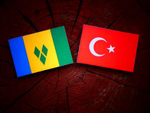 Saint Vincent and the Grenadines flag with Turkish flag on a tree stump  Stock Photos