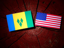 Saint Vincent and the Grenadines flag with USA flag on a tree st Stock Photography