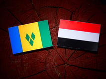Saint Vincent and the Grenadines flag with Yemeni flag on a tree. Stump isolated Stock Photo