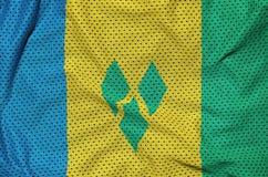 Saint Vincent och Grenadinerna flagga som skrivs ut på en polyesternyl stock illustrationer