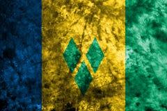 Saint Vincent och Grenadinerna grungeflagga på den gamla smutsiga väggen vektor illustrationer
