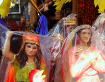 Saint and virgin  figurines in mexican market Royalty Free Stock Photo