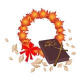 Sainte Bible avec la guirlande de Noël de l'érable orange Photographie stock libre de droits