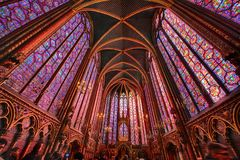 The Sainte Chapelle in la Cite of Paris. Spectacular stained glass windows and mosaics inside of the Sainte Chapelle of Paris Royalty Free Stock Photos