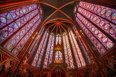 The Sainte Chapelle in la Cite of Paris. Spectacular stained glass windows and mosaics inside of the Sainte Chapelle of Paris Royalty Free Stock Images