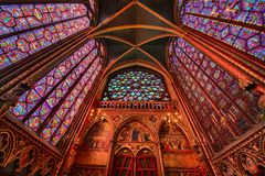 The Sainte Chapelle in la Cite of Paris. Spectacular stained glass windows and mosaics inside of the Sainte Chapelle of Paris Royalty Free Stock Photo