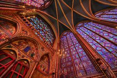 The Sainte Chapelle in la Cite of Paris. Spectacular stained glass windows and mosaics inside of the Sainte Chapelle of Paris Stock Images