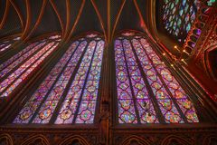 The Sainte Chapelle in la Cite of Paris. Spectacular stained glass windows and mosaics inside of the Sainte Chapelle of Paris Stock Photos
